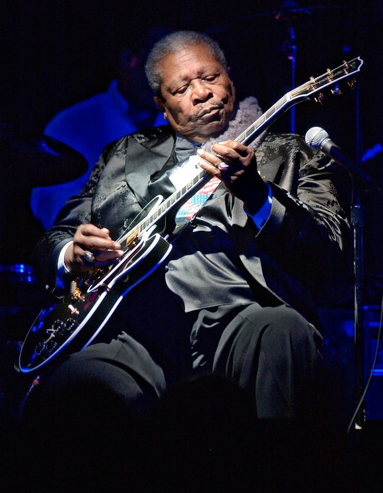 """FILE – This June 20, 2002 file photo shows blues legend B.B. King performing at the second anniversary celebration of B.B. King's Blues Club and Grill in New York. A guitar given to B.B. King for his 80th birthday has sold for $280,000 at an auction of items from the blues legend's estate. Julien's Auctions says King often used the black Gibson ES-345 prototype that was one of several guitars he called """"Lucille. (AP Photo/Richard Drew, File)"""