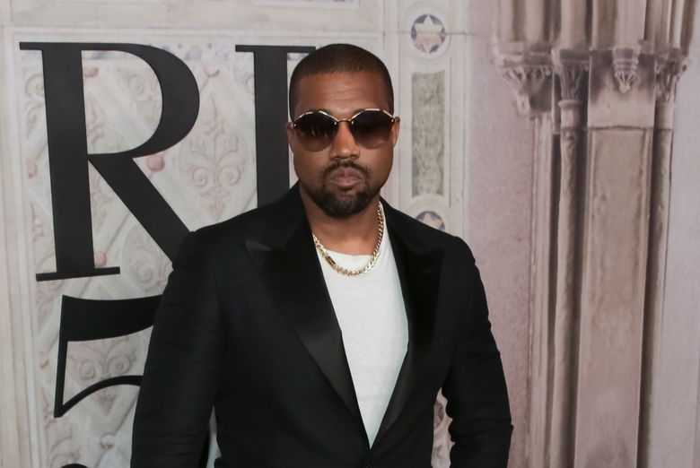 """FILE – In this Sept. 7, 2018, file photo, Kanye West attends the Ralph Lauren 50th Anniversary Event held at Bethesda Terrace in Central Park during New York Fashion Week in New York. West brought his collection of choir singers and musicians to an Atlanta-area megachurch for his religious popup performance called """"Sunday Service."""" News outlets reported West visited New Birth Missionary Baptist Church on Sunday, Sept. 15, 2019, drawing a large group of parishioners and celebrities. West's popup group has made various appearances on Sundays since January including a stop in Dayton, Ohio at a benefit event supporting the community affected by the mass shooting. (Photo by Brent N. Clarke/Invision/AP, File)"""