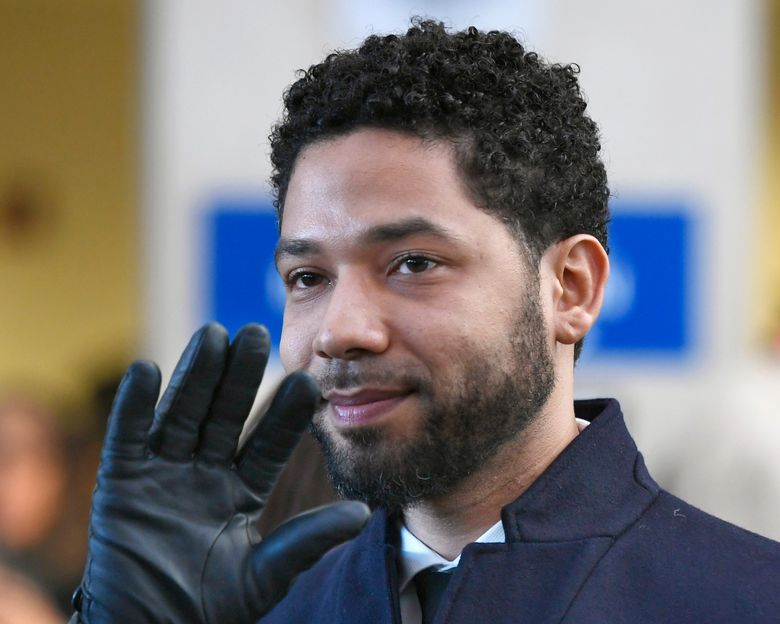 FILE – In this March 26, 2019, file photo, actor Jussie Smollett smiles and waves to supporters before leaving Cook County Court after his charges were dropped in Chicago. Smollett's attorneys have filed a motion this week arguing that the actor should not have to pay the city of Chicago $130,000 for the police investigation into what he claimed was a racist and homophobic attack in January, because he had no way of knowing how much time and money the department would spend on the probe. (AP Photo/Paul Beaty, File)