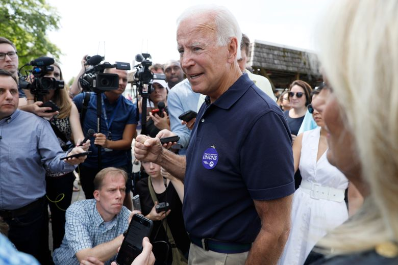 Democratic presidential candidate former Vice President Joe Biden speaks to reporters during the Hawkeye Area Labor Council Labor Day Picnic, Monday, Sept. 2, 2019, in Cedar Rapids, Iowa. (AP Photo/Charlie Neibergall)