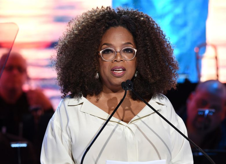 """FILE – In this May 15, 2019 file photo, Oprah Winfrey speaks at the Statue of Liberty Museum opening celebration at Battery Park in New York. Winfrey announced Wednesday, Sept. 4, 2019, that she will embark on a nine city arena tour called """"Oprah's 2020 Vision: Your Life in Focus,"""" that will focus on maintaining a healthy lifestyle. The tour will begin Jan. 4, 2020 in Fort Lauderdale, Fla., and end in early March in Denver.  (Photo by Evan Agostini/Invision/AP, File)"""