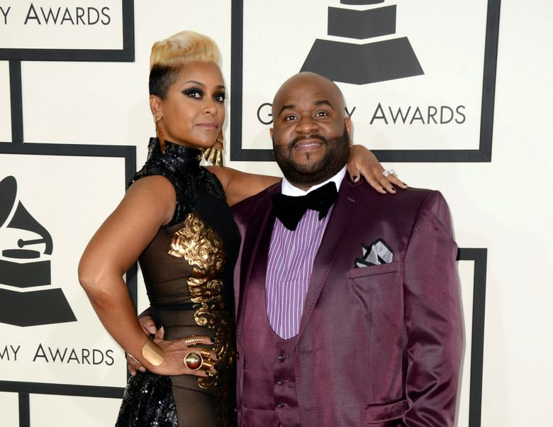 """FILE – This Jan. 26, 2014 file photo shows songwriter LaShawn Daniels, right, and his wife April Daniels at the 56th annual Grammy Awards in Los Angeles. LaShawn Daniels, a Grammy Award-winning songwriter who penned songs for Beyoncé, Whitney Houston and Lady Gaga died, Tuesday, Sept. 3, 2019, in a fatal car accident in South Carolina. He was 41. He earned a Grammy in 2001 for his songwriting work on Destiny Child's """"Say My Name."""" (Photo by Jordan Strauss/Invision/AP, File)"""