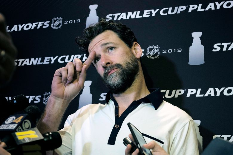 """FILE – In this Wednesday, May 8, 2019, file photo, Carolina Hurricanes' Justin Williams talks with reporters during an NHL hockey media availability in Boston. Hurricanes captain Justin Williams says he is taking a break from the NHL to start this season. The 37-year-old forward said in a statement Monday, Sept. 2, 2019, that he will """"step away"""" from the sport. (AP Photo/Steven Senne, File)"""