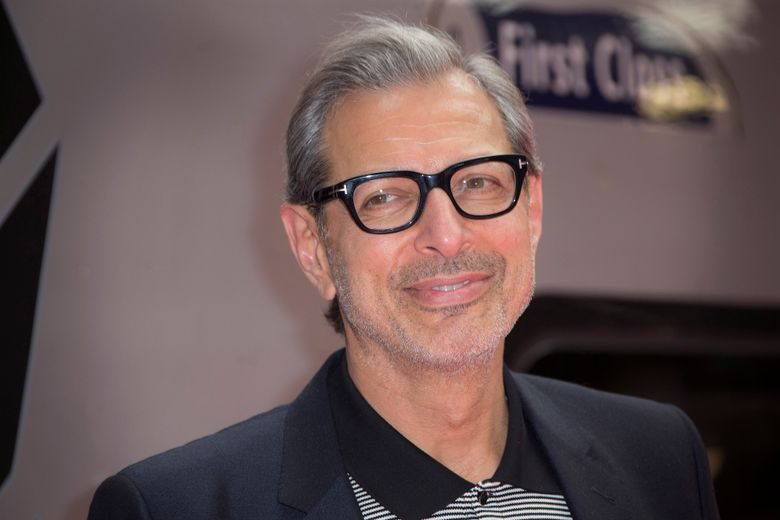 """FILE – In this June 6, 2016, file photo, actor Jeff Goldblum poses for photographers at the photo call for the film Independence Day Resurgence at Euston Station in London.  Goldblum, Laura Dern and Sam Neill will reprise their """"Jurassic Park"""" roles in the upcoming """"Jurassic World 3."""" Their castings were announced Tuesday, Sept. 24, 2019 by executive producer and director Colin Trevorrow.   (Photo by Joel Ryan/Invision/AP, File)"""
