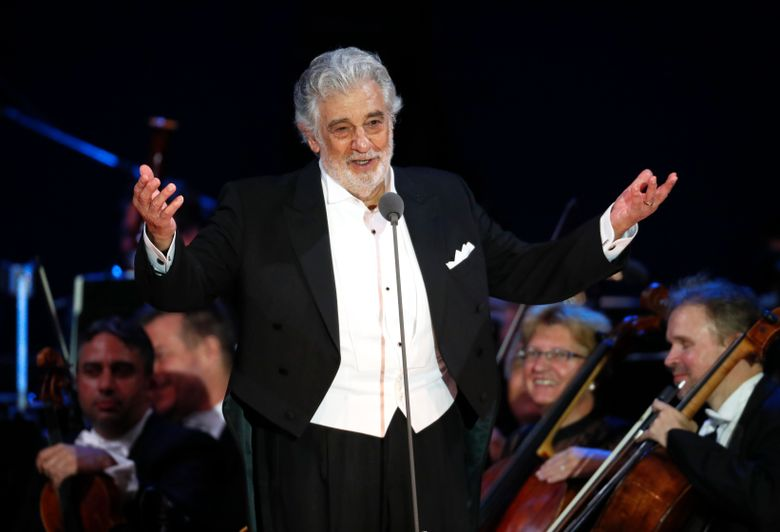 FILE – In this Aug. 28, 2019 file photo, opera star Placido Domingo salutes spectators at the end of a concert in Szeged, Hungary. The union that represents opera performers has launched its own investigation into sexual harassment allegations against Domingo, saying it cannot be sure that opera companies will delve into them sufficiently themselves. The American Guild of Musical Artists said its investigation was prompted by two Associated Press stories in which multiple women accused the opera legend of sexual harassment or other inappropriate conduct. (AP Photo/Laszlo Balogh, File)