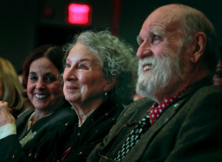 FILE – In this March 16, 2017 file photo, author Margaret Atwood, center, appears with her editor Nan Talese, left, and husband  Graeme Gibson as she is introduced for the Ivan Sandrof Lifetime Achievement Award at the National Book Critics Circle awards ceremony in New York. Gibson, a Canadian novelist and conservationist has died. His death was announced Wednesday, Sept. 18, 2019 by Doubleday, which has published both Gibson and Atwood. He was 85 and had been suffering from dementia. (AP Photo/Julie Jacobson, File)