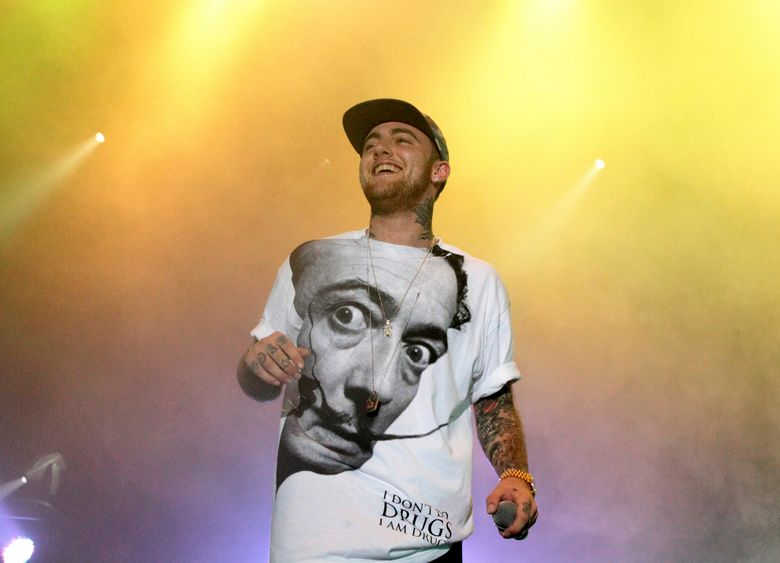 FILE – In this July 13, 2013, file photo, rapper Mac Miller performs on his Space Migration Tour in Philadelphia. A man has been charged with selling counterfeit opioid pills to Mac Miller two days before the rapper died of an overdose.  An autopsy found that the 26-year-old Miller died in his Los Angeles home on Sept. 7 from a combination of fentanyl, cocaine and alcohol.  (Photo by Owen Sweeney/Invision/AP, File)