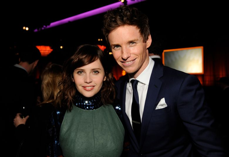 """FILE – This Feb. 2, 2015 file photo shows Felicity Jones, left, and Eddie Redmayne at the 87th Academy Awards nominees luncheon in Beverly Hills, Calif. Jones and Redmayne, who starred in """"Theory of Everything,"""" reunite for their latest film """"The Aeronauts."""" (Photo by Chris Pizzello/Invision/AP, File)"""