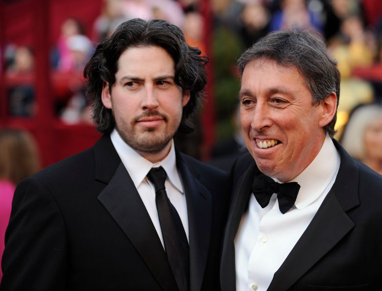 """FILE – In this Feb. 24, 2008 file photo, Jason Reitman, left, an Oscar nominee for best director for his work on """"Juno,"""" arrives with his father, director Ivan Reitman for the 80th Academy Awards in Los Angeles. The upcoming """"Ghostbuster"""" sequel will focus on the descendants of the original ghost-catchers who rushed around New York City in proton packs and jumpsuits. Ivan Reitman and Dan Aykroyd revealed details of the new film, saying it is expected out next year and will star Paul Rudd, Finn Wolfhard, Carrie Coon and McKenna Grace. Reitman directed the original 1984 film and Aykroyd co-wrote and co-starred in it. Reitman's son, Jason, is directing the new movie. (AP Photo/Chris Pizzello, File)"""