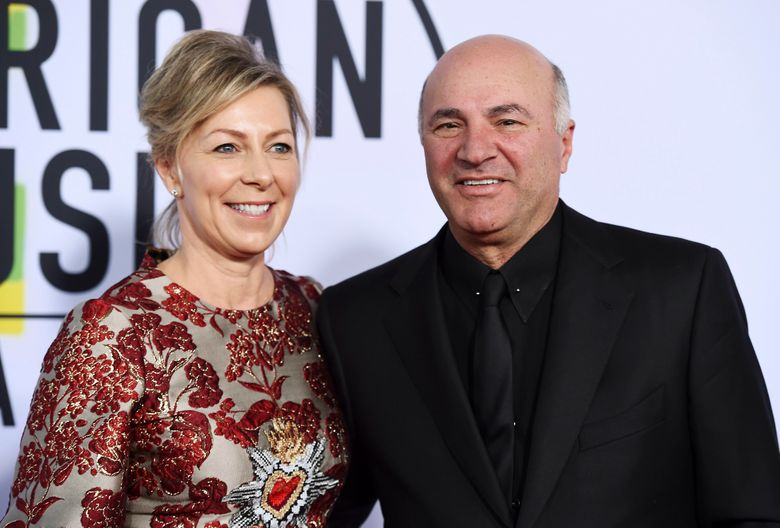 """FILE – In this Nov. 19, 2017, file photo, Linda O'Leary and Kevin O'Leary arrive at the American Music Awards at the Microsoft Theater in Los Angeles. Linda O'Leary, the wife of """"Shark Tank"""" star Kevin O'Leary, has been charged with careless operation of a vessel in a fatal boat crash in Canada, authorities said Tuesday, Sept. 24, 2019. (Photo by Jordan Strauss/Invision/AP, File)"""