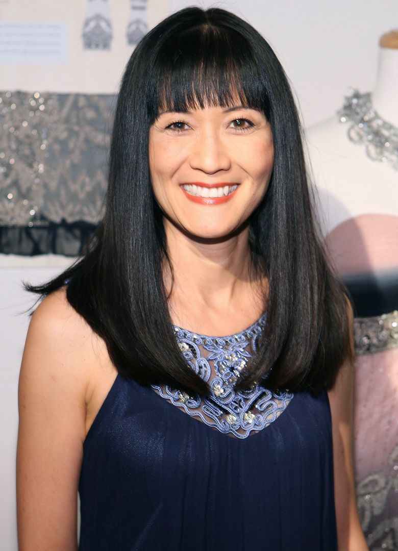 """FILE – In this March 6, 2010 file photo, Suzanne Whang attends the Sue Wong Fall 2010 Preview, in Los Angeles. Whang, whose smooth, calm voice provided the narration for HGTV's """"House Hunters"""" for years, died Tuesday, Sept. 17, 2019. She was 57. (Shea Walsh / AP Images for Sue Wong, File)"""