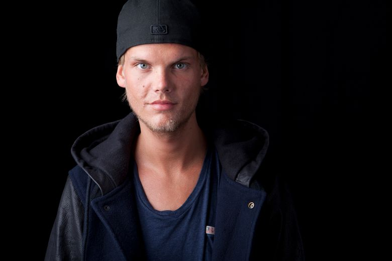 FILE – In this Aug. 30, 2013 file photo, Swedish DJ, remixer and record producer Avicii poses for a portrait, in New York. A benefit concert for suicide prevention featuring the music of the late star Avicii is being planned for Dec. 5, 2019, in Stockholm, Sweden. Proceeds will support the work of the new Tim Bergling Foundation, named for the musician who killed himself in April 2018. (Photo by Amy Sussman/Invision/AP, File)