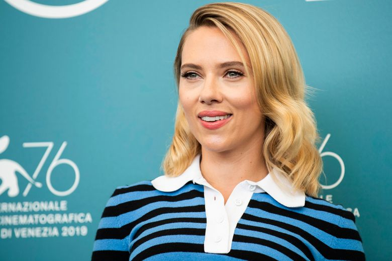 """FILE – This Aug. 29, 2019 file photo shows actress Scarlett Johansson at the photo call for the film 'Marriage Story' at the 76th edition of the Venice Film Festival in Venice, Italy. Johansson said in a fresh interview that she's standing by Woody Allen. """"I love Woody,"""" Johansson told The Hollywood Reporter. """"I believe him, and I would work with him anytime."""" (Photo by Arthur Mola/Invision/AP, File)"""
