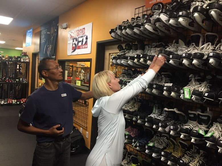 John Florendo and his wife, Julie, have had a tough time keepng the used skate section stocked at their Play It Again Sports store in Lynnwood. The store sells skates and other used hockey equipment, helping players and parents offset some costs in one of ths country's most expensive sports to play. (Geoff Baker/Seattle Times)