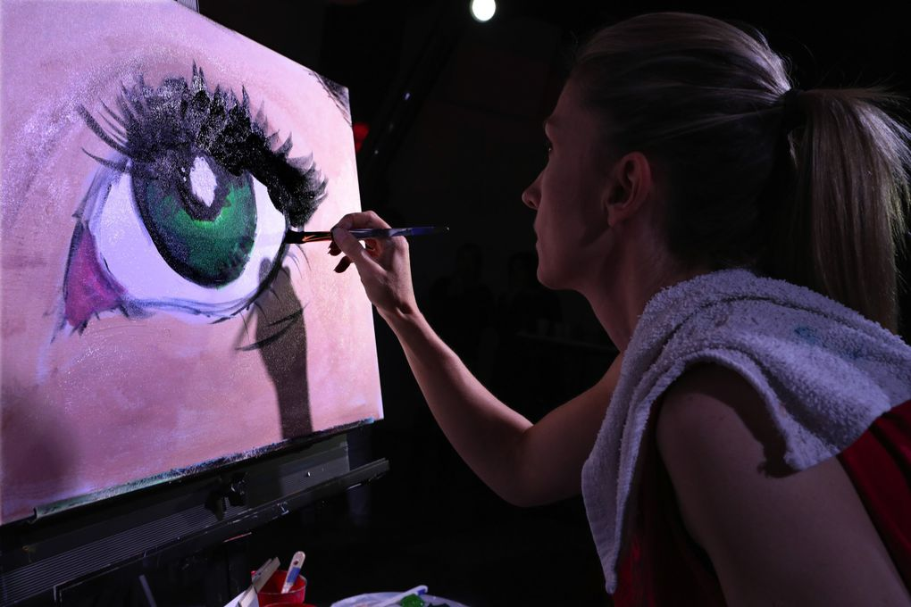 Ciera Christensen's painting is almost finished as the clock ticks down. (Alan Berner / Seattle Times)