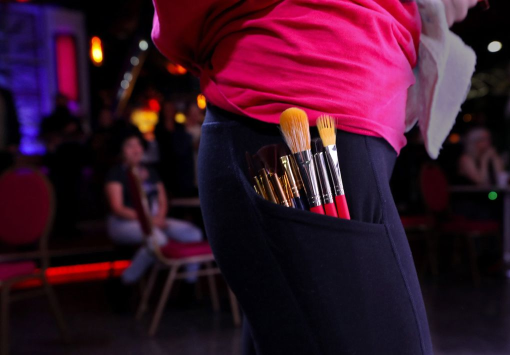 Ciera Christensen keeps her brushes at the ready at last month's Art Battle Seattle. (Alan Berner / Seattle Times)