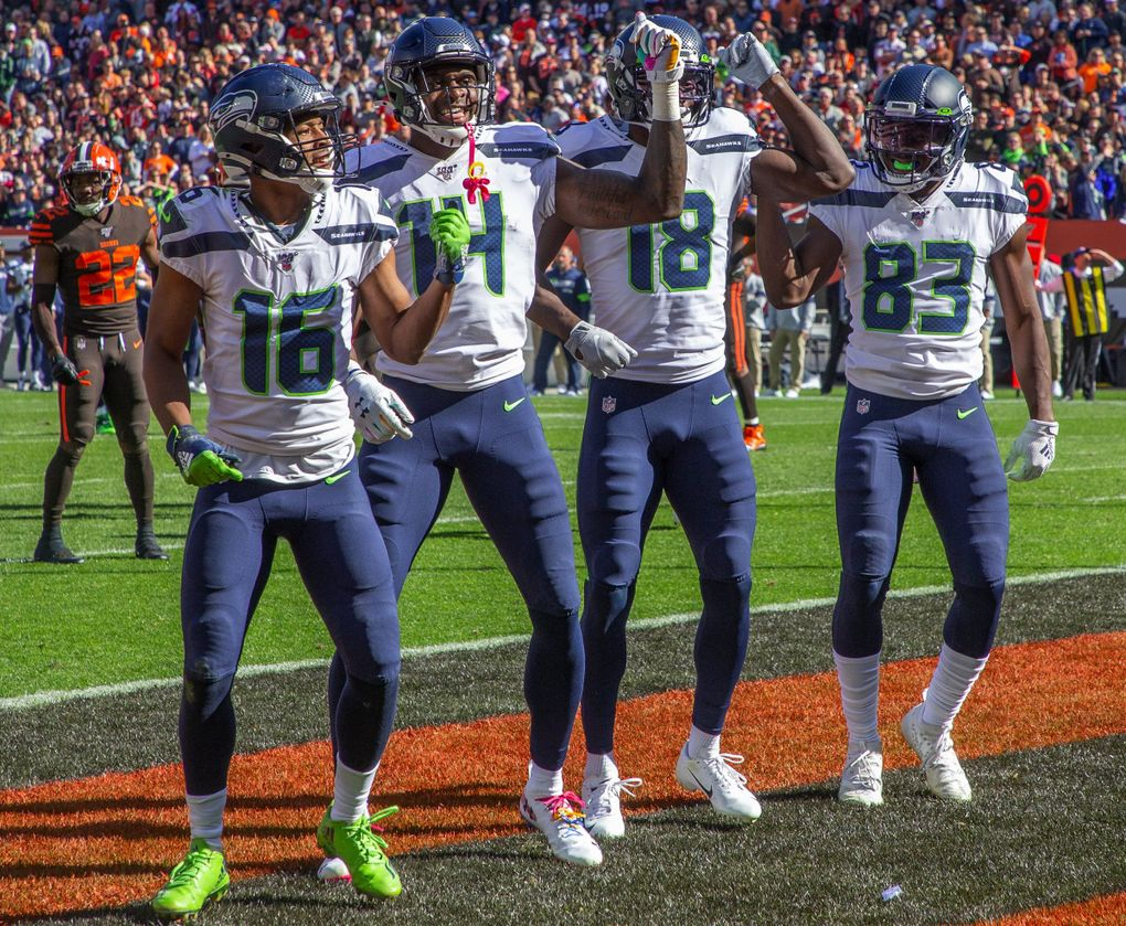 Seahawks wide receivers (left to right) Tyler Lockett, DK Metcalf, Jaron Brown and David Moore celebrate Brown's first-half touchdown Sunday in Cleveland. (Mike Siegel / The Seattle Times)