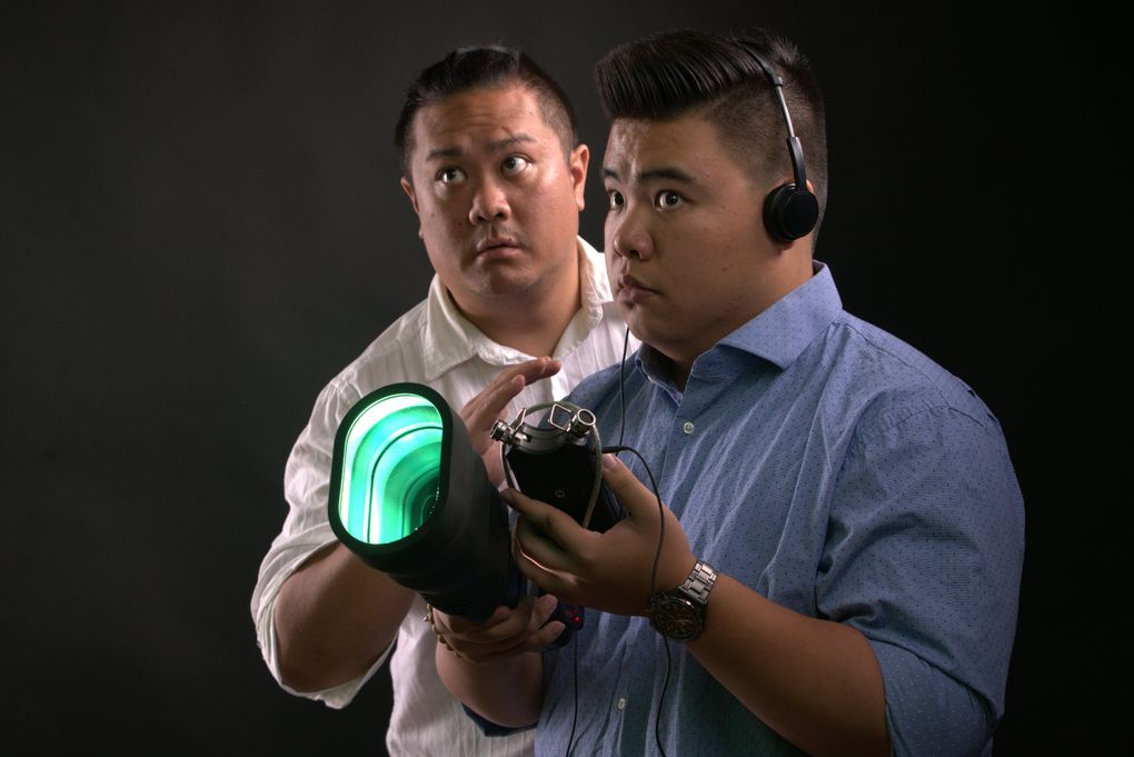 """Van Lang Pham (left) and Sean Nguyen play ghost-hunting brothers in Pork Filled Players' production of """"The Brothers Paranormal"""" at Theatre Off Jackson through Nov. 16. (Alabastro Photography)"""