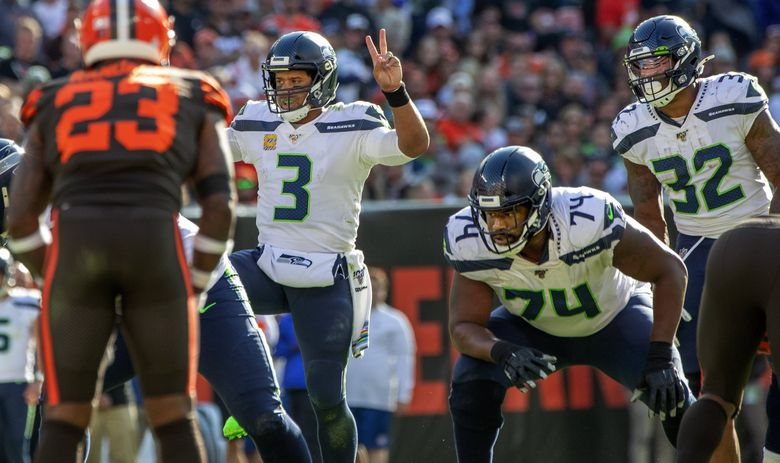 Seattle Seahawks quarterback Russell Wilson (3) calls a play from the line of scrimmage against the Cleveland Browns at FirstEnergy Stadium in Cleveland on October 13, 2019. (Mike Siegel / The Seattle Times)