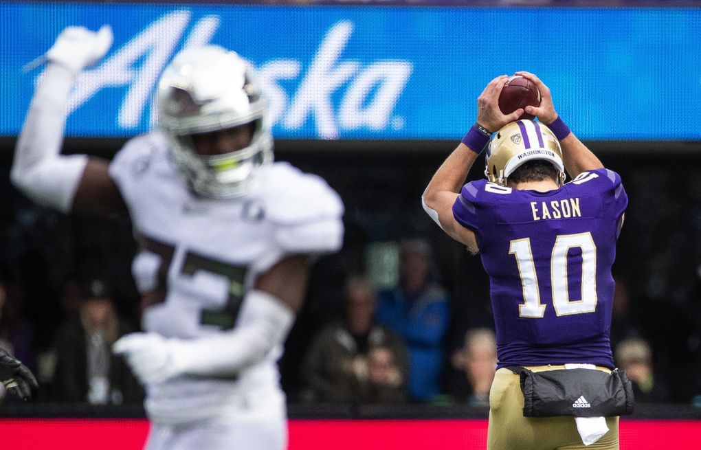 Jacob Eason appears to want to drill the ball into the turf after the Huskies were called for being offsides, leaving the Dawgs 3rd and 23 in their final series of the game.  The 12th-ranked Oregon Ducks played the 25th-ranked Washington Huskies Friday, October 18, 2019 at Husky Stadium in Seattle, WA. (Dean Rutz / The Seattle Times)