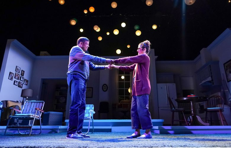 """Eugene Lee (left) and Alexandra Tavares in """"The Great Moment,"""" a new play about savoring life when it's going well at Seattle Repertory Theatre. (Alan Alabastro)"""