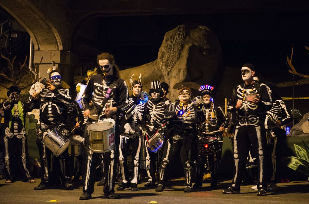 On Halloween, the Fremont Troll celebrates his birthday and the Fremont Arts Council throws a street party in his honor. In 2013, the VamoLa Brazilian Drum and Dance Ensemble performed during Trolloween. (Lindsey Wasson / The Seattle Times)