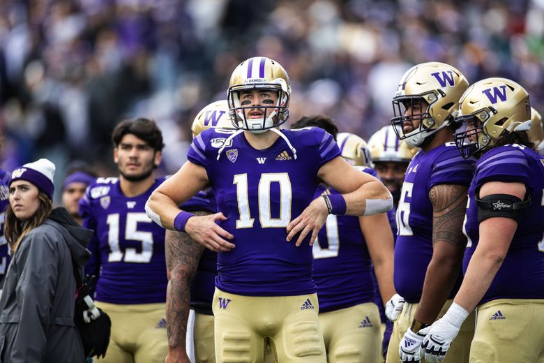 Jacob Eason and the Huskies watch the replay on the screen late in the 3rd quarter.  The 12th-ranked Oregon Ducks played the 25th-ranked Washington Huskies Friday, October 18, 2019 at Husky Stadium in Seattle. (Dean Rutz / The Seattle Times)