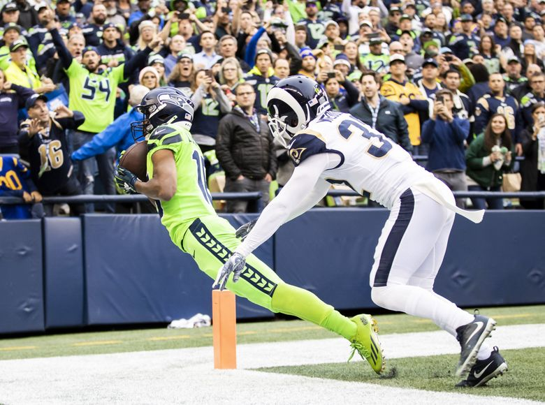 Seahawks wide receiver Tyler Lockett catches a 13-yard, toe-dragging touchdown against Rams free safety Eric Weddle in the first quarter as the Seattle Seahawks take on the Los Angeles Rams at CenturyLink Field in Seattle Thursday October 3, 2019.  (Dean Rutz / The Seattle Times)