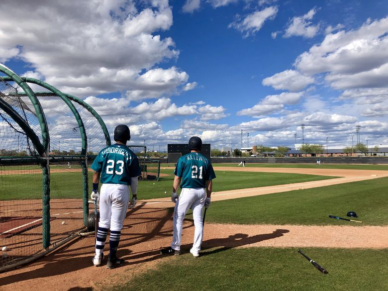 Seattle Mariners top prospects Julio Rodriguez and Jarred Kelenic during  spring training in Peoria, Ariz.  (Adam Jude / The Seattle Times)