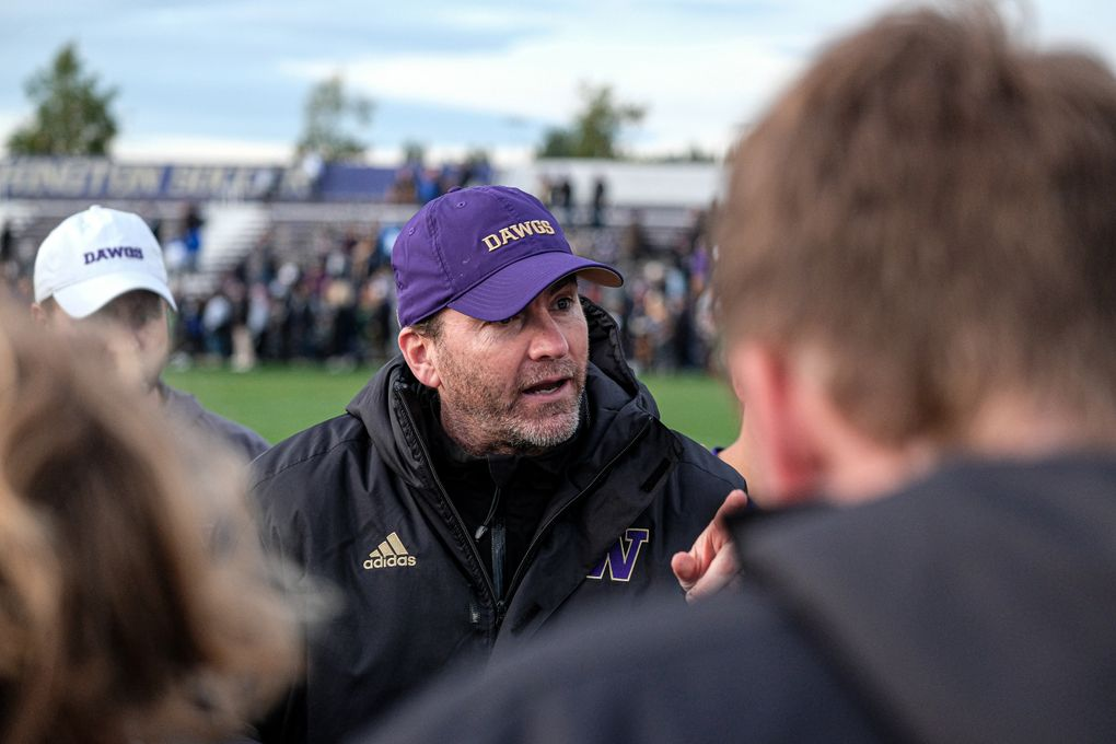 Washington soccer coach Jamie Clark talks to his team during a game this season.(Scott Eklund / Red Box Pictures)