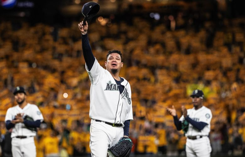 A tearful Felix Hernandez salutes the T-Mobile Park faithful as he goes out of the ballgame Thursday, September 26, 2019. Hernandez never got to pitch in the playoffs as a Mariner. (Dean Rutz / The Seattle Times)
