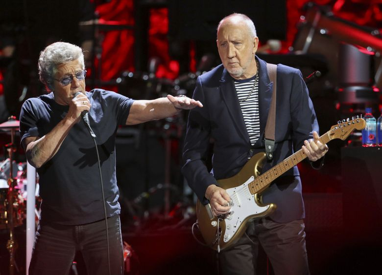 The Who, featuring Roger Daltrey and Pete Townshend, stops in Seattle Oct. 19. As part of its Moving On! U.S. tour, the band plays with a local orchestra at each stop. (Robb Cohen / Invision / AP)