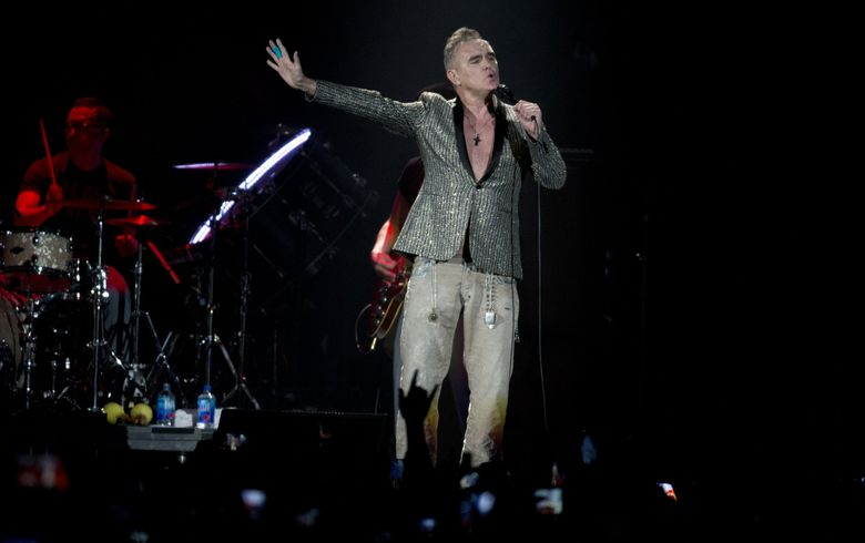 Controversial indie rock star Morrissey canceled his Tuesday concert in Seattle one day after having a protester removed from his Portland show. (AP Photo/Eduardo Verdugo)