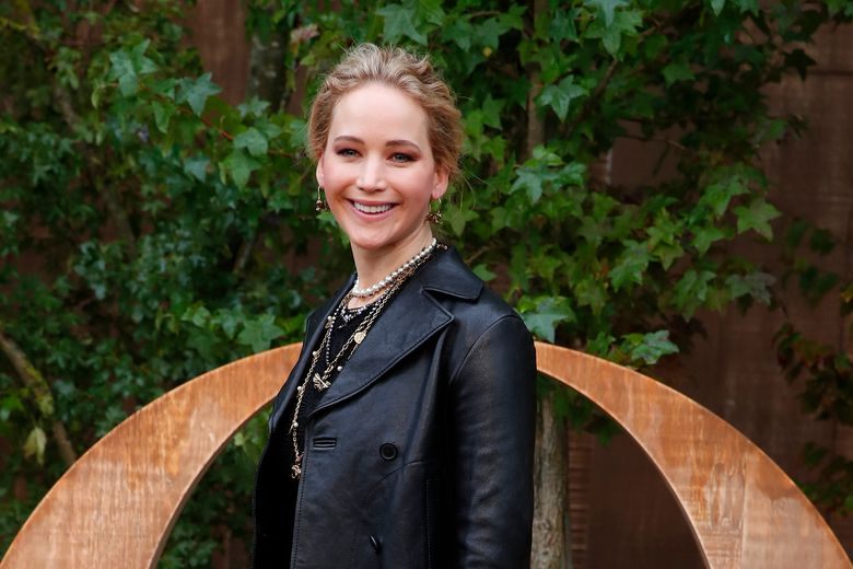 """FILE – In this Sept. 24, 2019 file photo, actress Jennifer Lawrence smiles during a photocall before Dior's Ready To Wear Spring-Summer 2020 collection, unveiled during the fashion week, in Paris. Lawrence got married over the weekend in Rhode Island during a ceremony and reception studded with Hollywood stars. The """"Hunger Games"""" and """"Silver Linings Playbook"""" star tied the knot with New York art dealer Cooke Maroney on Saturday, Oct. 19 at a Newport mansion. Lawrence's publicist confirmed to The Associated Press the wedding took place. (AP Photo/Francois Mori, File)"""