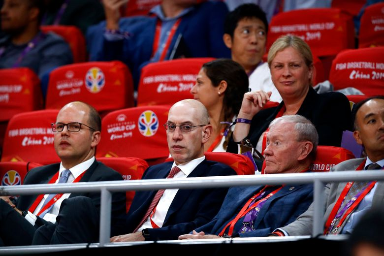 In this Sept. 13, 2019, file photo, NBA Commissioner Adam Silver, second from left, attends the semifinal match between Argentina and France in the FIBA Basketball World Cup at the Cadillac Arena in Beijing. The multibillion-dollar relationship between China and the NBA is strained right now in ways unlike any other since the league first began planting roots there three decades ago. (AP Photo/Mark Schiefelbein, File)