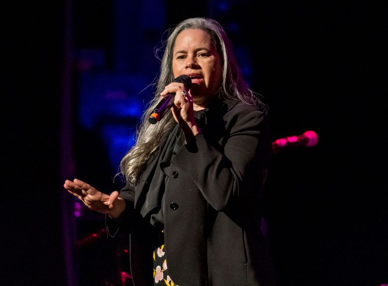 """FILE – This Dec. 8, 2018 file photo shows Natalie Merchant performing at Cyndi Lauper's 8th Annual """"Home for the Holidays"""" benefit concert in New York. Merchant is the sixth recipient of the John Lennon Real Love Award, and will headline a  tribute concert to the former Beatle in New York on Dec. 6. She's also getting an award from ASCAP this month. (Photo by Charles Sykes/Invision/AP, File)"""