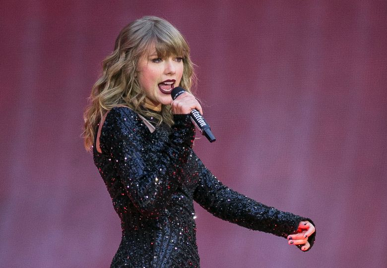 FILE – In this June 22, 2018, file photo, singer Taylor Swift performs on stage in concert at Wembley Stadium in London. A 27-year-old Austin, Texas, man has pleaded guilty to stalking and sending threatening letters and emails to pop star Taylor Swift's former record label. Federal prosecutors in Nashville, Tennessee, said in a news release the letters to Big Machine Label Group began in January 2018 with Eric Swarbrick asking the CEO to introduce him to Swift. (Photo by Joel C Ryan/Invision/AP, File)
