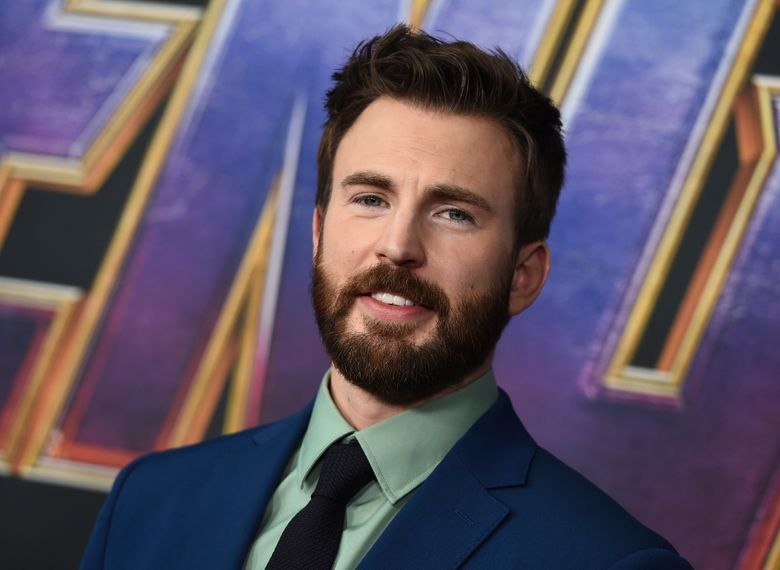 """FILE – In this April 22, 2019 file photo, Chris Evans arrives at the premiere of """"Avengers: Endgame"""" at the Los Angeles Convention Center. The """"Captain America"""" actor returned to his native Massachusetts to help dedicate the new home of a youth theater company where as a youngster he honed his acting skills. Evans helped cut the ribbon Saturday, Oct. 19 at the Concord Youth Theatre's permanent home. Evans, who grew up in nearby Sudbury, acted in Concord Youth Theatre productions starting when he was 9 years old. His mother, Lisa Evans, is the theater's director.  (Photo by Jordan Strauss/Invision/AP, File)"""