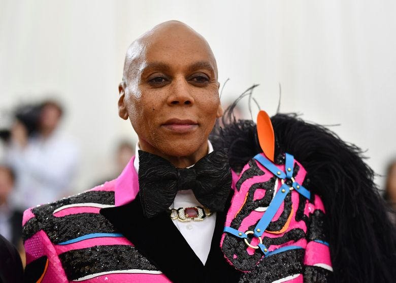 """FILE – This May 6, 2019 file photo shows RuPaul at The Metropolitan Museum of Art's Costume Institute benefit gala celebrating the opening of the """"Camp: Notes on Fashion"""" exhibition in New York. RuPaul is giving a dozen celebrities the chance to get drag makeovers for charity and bragging rights. VH1 said Tuesday, Oct. 22, that """"RuPaul's Celebrity Drag Race"""" will air as a limited series next year. (Photo by Charles Sykes/Invision/AP, File)"""