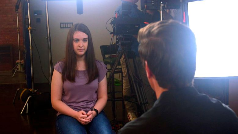"""In this August 2019 photo provided by ABC News, Payton Leutner, left, is interviewed by ABC's David Muir. Leutner, of Wisconsin, survived a stabbing attack in 2014 by two teenage friends wanting to please a fictional horror character called Slender Man. In her first interview about the attack, which is set to air Friday, Oct. 25,  Leutner told ABC News that despite her lingering trauma, she has """"come to accept all of the scars that I have."""" (ABC News via AP)"""