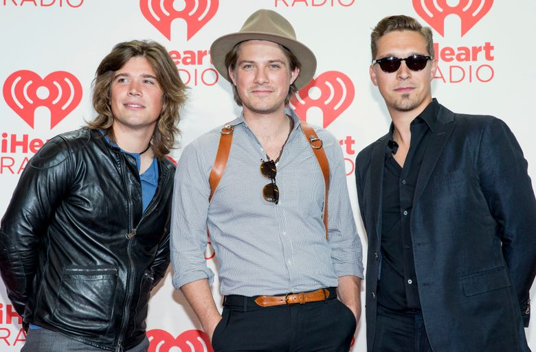 """FILE – In this Sept. 21, 2013 file photo, from left, Zac, Taylor, and Isaac Hanson, arrive at the iHeartRadio Music Festival at the MGM Grand Garden Arena in Las Vegas.  Zac Hanson  is recovering following a motorcycle crash in Tulsa, Okla. this week of Oct. 5, 2019. The 33-year-old Hanson said in posts on Twitter, Facebook and the band's website that he is recovering after suffering a broken collarbone, three broken ribs, and a cracked scapula. Hanson said he was able to walk away from the crash thanks to """"good quality protective gear.""""  (Photo by Eric Jamison/Invision/AP Images)"""