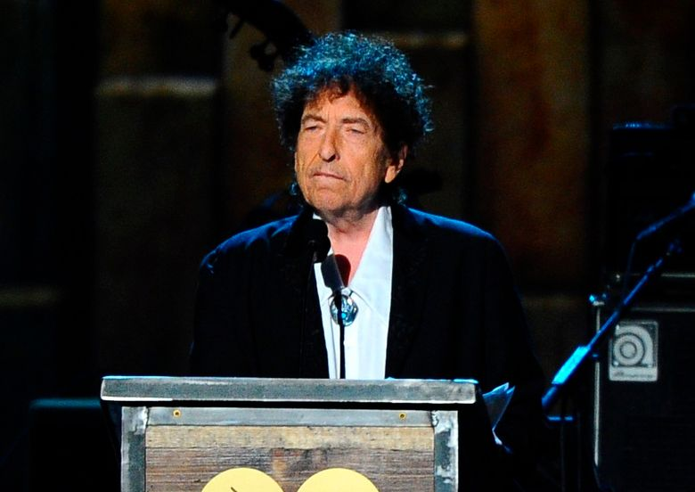 """FILE – In this Feb. 6, 2015 file photo, Bob Dylan accepts the 2015 MusiCares Person of the Year award at the 2015 MusiCares Person of the Year show in Los Angeles. Dylan's """"Tarantula,"""" a stream-of-consciousness work first released in 1971, is finally coming out in audio. Simon & Schuster announced Tuesday, Oct. 15, 2019, that Will Patton is the narrator, reciting such lines as """"raggedy ann daughter of brazos and teeth in the necklace."""" Dylan first wrote """"Tarantula"""" in the mid-1960s, at the height of his career. But his 1966 motorcycle accident delayed publication and made the book a kind of underground legend, with unauthorized versions turning up. (Photo by Vince Bucci/Invision/AP, File)"""