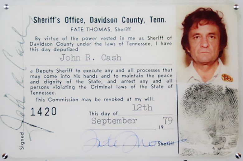 This 1979 image released by the Davidson County (Tenn.) Sheriff's Office via the Johnny Cash Museum, shows Cash's Deputy Sheriff ID card. This week at the Johnny Cash Museum in Nashville, Sheriff Daron Hall unveiled an image of the late musician's September 1979 deputy sheriff commission card.  (Davidson County Sheriff's Office / Johnny Cash Museum via AP)