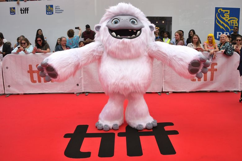 """FILE – In this Sept. 7, 2019, file photo, the character Everest from the film """"Abominable"""" appears on the red carpet on day three of the Toronto International Film Festival at Roy Thomson Hall in Toronto. Vietnam has pulled """"Abominable"""" from theaters because the U.S.-Chinese-made animated movie showed a map supporting Chinese claims to the disputed South China Sea. (Photo by Evan Agostini/Invision/AP, File)"""