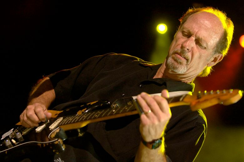 FILE – In an April 20, 2006 file photo, Paul Barrere and Little Feat perform during the Sixth Annual Jammy Awards at the Theater at Madison Square Garden  in New York. Paul Barrere, guitarist and singer for the rock group Little Feat, has died. Little Feat said Barrere died Saturday Oct. 26, 2019 at UCLA Hospital in Los Angeles due to side effects from an ongoing treatment for liver disease.He was 71.  (AP Photo/Jason DeCrow, File)
