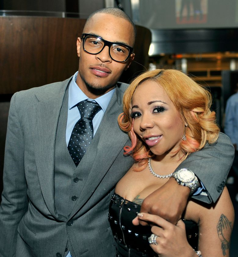 """FILE – In this Oct. 3, 2010 file photo, Grammy award winning artist Clifford """"TI"""" Harris, left, poses for the media with his wife reality star Tameka """"Tiny"""" Harris, right, during an Alzheimers """"For the Love of Our Fathers"""" foundation honoree luncheon at the Luckie Lounge in Atlanta. Harris says $750,000 dollars' worth of jewelry was stolen from her Lamborghini outside of an Atlanta bar on Sunday, Oct. 6, 2019. (AP Photo/Gregory Smith, File)"""