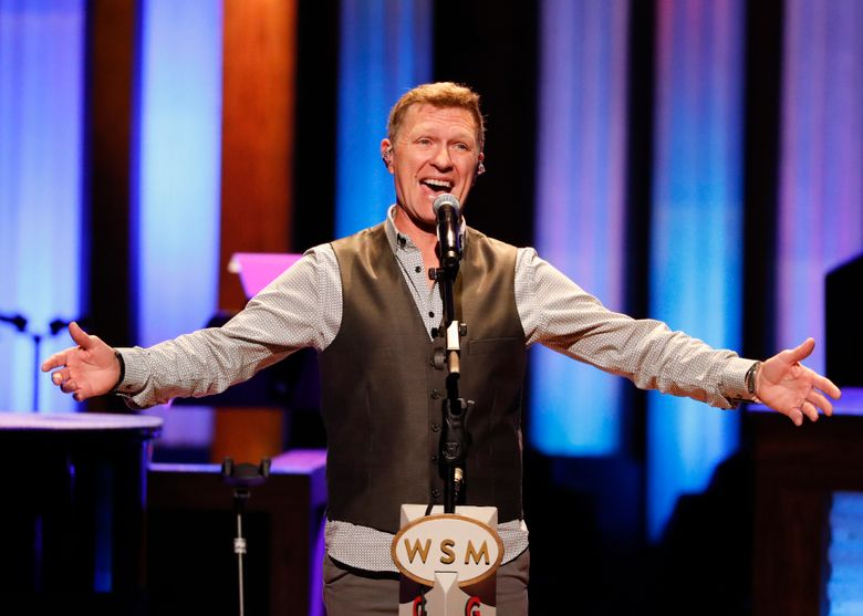 """FILE – This July 16, 2019 file photo shows Craig Morgan performing at """"Luke Combs Joins the Grand Ole Opry Family"""" at Grand Ole Opry in Nashville, Tenn. Three years after country singer Craig Morgan lost his 19-year-old son in a drowning accident, he wrote a song about his grief, pain and his faith, called """"The Father, My Son, and the Holy Ghost."""" He performed it on the Grand Ole Opry and sent a recorded version to his friend and fellow Opry member Blake Shelton. Shelton started an impromptu social media campaign to promote the song, which caused a widespread response of fans reaching out to Morgan. (Photo by Al Wagner/Invision/AP, File)"""