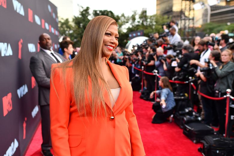FILE – In this Monday, Aug. 26, 2019, file photo, Queen Latifah arrives at the MTV Video Music Awards at the Prudential Center in Newark, N.J. Musical artist and actress Queen Latifah is among the honorees being recognized by Harvard University this year for their contributions to black history and culture. Harvard is set to award the W.E.B. Du Bois Medal to Queen Latifah and six other recipients on Oct. 22. (Photo by Charles Sykes/Invision/AP, File)