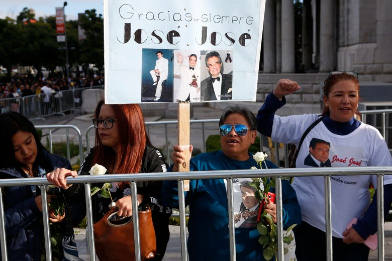 Fans waits outside the Palace of Fine Arts to say farewell to the ashes of Mexican singer Jose Jose, in Mexico City, Wednesday, Oct 9, 2019. Jose Jose died Sept. 28 in South Florida. His body was cremated in Miami, and it was agreed after a dispute among relatives over where his remains, that half the ashes would remain there and the other half would be brought to Mexico. (AP Photo/Ginnette Riquelme)