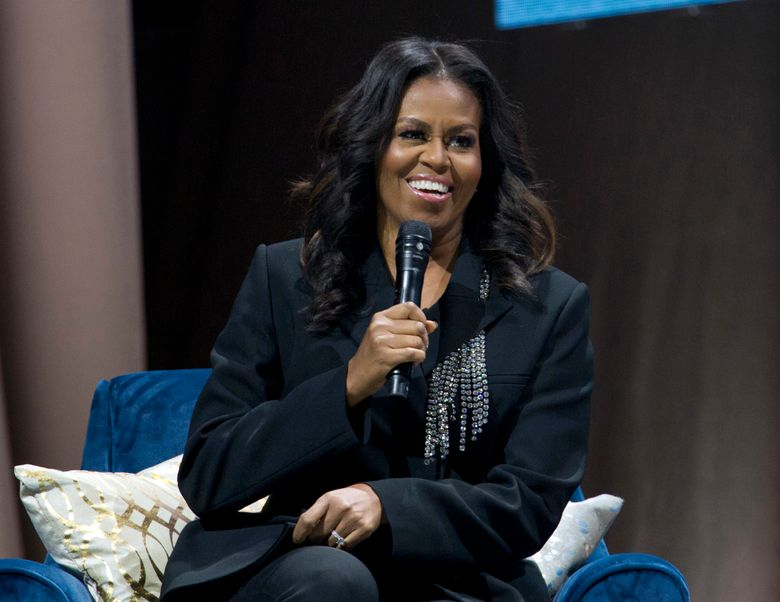 """FILE – In this Nov. 17, 2018 file photo, former first lady Michelle Obama speaks to the crowd as she presents her anticipated memoir """"Becoming"""" during her book tour stop in Washington.  Obama's first project since """"Becoming"""" is more about her readers than about herself. """"Becoming: A Guided Journal for Discovering Your Voice"""" will be published Nov. 19, 2019, by Clarkson Potter, an imprint of Penguin Random House. The new release was announced Monday, Oct. 7 and is a companion to her multimillion-selling """"Becoming,"""" which came out last November. It features an introduction by the former first lady and quotations and questions related to her memoir and is designed to help readers tell their own stories. (AP Photo/Jose Luis Magana, File)"""